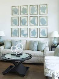 White Blue Coastal Beachy Living Room Design With Gray Slip Covered Sofa Lamp Black Modern Coffee Table End Tables And Coral Art