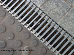 Garden by the Bay trench drain system stone paver trench drain