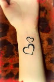 Love Symbol Wrist Tattoo