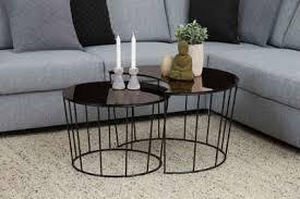 andas couchtisch susan mit tischplatte aus bronzefarbigem spiegelglas und metall gestell