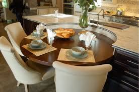 Mix And Match New American Home The Smooth Circular Breakfast Table Complements Its Attached Rectangular Corian Island