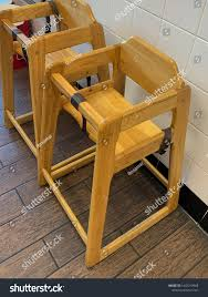Wooden Baby Restaurant High Chair Security Stock Photo (Edit ... Baby Or Toddler Wooden High Chair Stock Photo 055739 Alamy Wooden High Chair Feeding Seat Toddler Amazoncom Lxla With Tray For Portable From China Olivias Little World Princess Doll Fniture White 18 Inch 38 Childcare Kid Highchair With Adjustable Bottle Full Of Milk In A Path Included Buy Your Weavers Folding Natural Metal Girls Kids Pretend Play Foho Perfect 3 1 Convertible Cushion Removable And Legs Grey For Sale Finest En Passed Hot Unique
