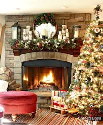 Rustic Lodge Style Family Room At Christmas With Corner Stone Fireplace And Vintage Wood Skis