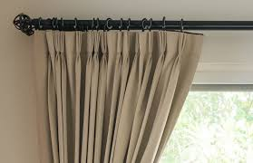 how high above my window do i fit my curtain pole