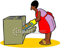 A Woman Taking Cookies Out of the Oven Royalty Free Clipart Picture