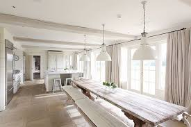 Open Kitchen With Extra Long Dining Room Table Bench Seating French Doors Floor Length Curtains And Three Pendant Lights