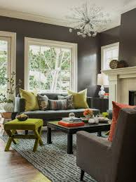 grey sofa and cushions also black wooden table and green ottoman