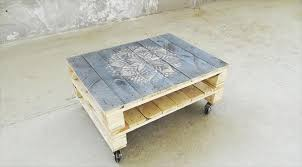 Repurposed Pallet Rolling Coffee Table With Patterned Top