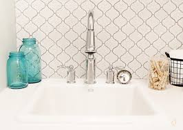 Bathroom Backsplash Tile Home Depot by Fun Bathroom Featuring White Arabesque Tile From Home Depot And