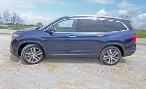 Honda Pilot Touring Captains Chairs by 2016 Honda Pilot Touring And Elite Moving On Up Review The