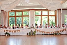 Long Head Table With Garland At Florian Gardens Reception