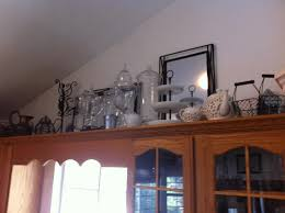 Above Kitchen Cabinet Decorations Pictures by Decorating Ideas For Above Kitchen Cabinets Plain Tan Ceramic