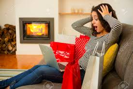 Beautiful Woman At Home At The Warmth Of The Fireplace Shopping