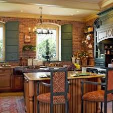 French Country Kitchen With Exposed Brick Wall