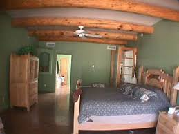 SW Bedroom Has Hand Peeled Pine Poles Vigas On Ceiling Two Tone Colorful Santa Fe
