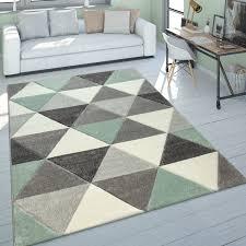 wohnzimmer teppich grün grau pastellfarben kurzflor retro design dreieck muster
