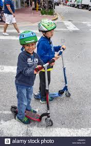 Miami Beach Florida Hispanic Boy Child Razor Scooter Helmet Safety Equipment Ninja Turtle Riding Friend