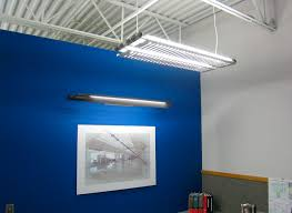 lighting ideas modern hanging fluorescent light fixture and wall