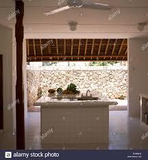 100 Modern Balinese Design Island Unit In Modern Kitchen Stock Photo