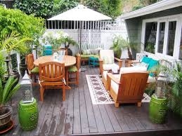 Small Patio And Deck Ideas by Cozy Sofa For Seating At Low Deck In Small Backyard Grabbing