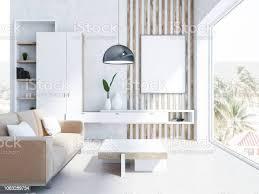 weiße wohnzimmer beige sofa und poster stockfoto und mehr bilder behaglich