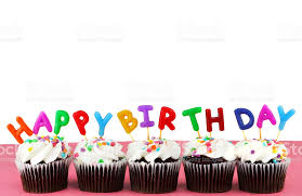 Happy Birthday Cupcakes with candles and white background royalty free stock photo