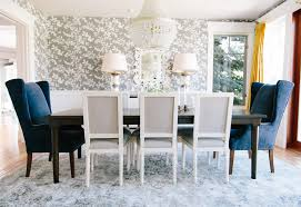 Stunning Formal Dining Room With Gray Wallpaper Yellow Drapes And Navy Velvet Wingbacks