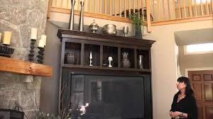 How To Decorate The Top Of An Entertainment Center & Bookcase ... Kitchen Mesmerizing Christmas Formal Outdoor Lights Decoration Bedroom Armoires Amazoncom Walmart Top Cyber Monday Finley Home Decor Deals Decorations Eertainment Center Interior Design Tv Yesterdays Wedding Decor Becomes Todays Home Bar Luxury Of Bar Diy Near Beach With Square Best 25 Armoire Decorating Ideas On Pinterest Orange Holiday Living Room Contemporary Decorating Ideas Green Mirror Jewelry For Svozcom Simple Wardrobe Closet Color Antique Wardrobe Eclectic Armoires