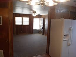 VIEW OF 12 X 16 LIVING ROOM TO FRONT DOOR FROM SEPARATE DINING