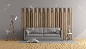 zeitgenössisches wohnzimmer mit grauem sofa und dekorativer holzverkleidung wiedergabe 3d