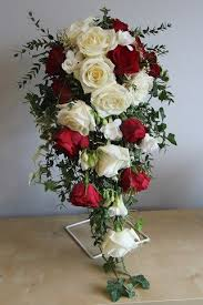 Red roses and ivory shower wedding bouquet with ivy and fressia s