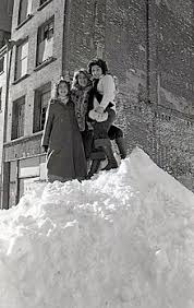 Women Standing Atop A Large Snowdrift From The Northeastern United States Blizzard Of 1978