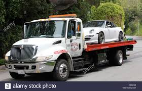 Tow Truck Tows Victoria Beckhams Stock Photos & Tow Truck Tows ... Cheap Towing Los Angeles Airtalk In An Accident Beware Of Tow Truck Scammers 893 Kpcc In 247 The Closest Tow Truck Service Nearby Types Equipment Green File1932 Ford Model Bb Truckjpg Wikimedia Commons Platinum Ventura Countys Premier Recovery Southland Best And Gallery Industries Ca Trucks United Carrier Services Auto Transport 90015 Cole Keattss Car During Red Bull Global R 2008 Gmc Topkick C5500 5003716866