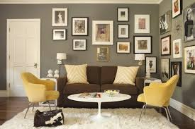 how to decorate a brown sofa and dark flooring