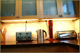 traditional kitchen with cabinet power light brown