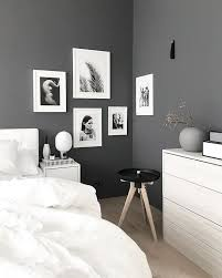 Stylish Grey And White Nordic Style BedroomThe Predominantly Artwork Helps Lighten Up The Stone Walls