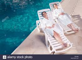 Two Women Resting On Lounge Chairs At Poolside Stock Photo ... Ss Officer Karl Hoecker Relaxes With Women In Lounge Chairs Pregnant For Household Siesta Break Lunch Portable Young Women Relaxing Lounge Chairs One People Stock Image Woman Resting On Chair By Swimming Pool Council Onollection Relaxing Laying And Reading Book On Chair D1007_11_067 Outdoor Fniture Beach Designed For Reading Lapu Cebu Photo Free Trial Bigstock Mocule Pakistan Twitter Who Lead Read Field Modern Blu Dot Two One Sitting Indian Style D984_32_449 Deltess Ostrich Ladies Blue Alinum Folding