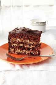This German Chocolate Cake Four Delicious Layers Sandwiched Together With A Super Rich Pecan