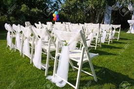 White Decorated Chairs On A Green Lawn. Chairs Set In Rows For ... 40 Pretty Ways To Decorate Your Wedding Chairs Martha Stewart Weddings San Diego Party Rentals Platinum Event Monogram Decorations Ideas Inside Tables And 1888builders Spandex Folding Chair Cover Lavender Padded Hire For Outdoor Parties In Sydney Can Plastic Look Elegant For My Ctc 23 Decoration White Galleryeptune Aisle Metal Unique Reception Seating