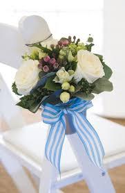 Beach Wedding Flowers The stunning pew end flower buckets