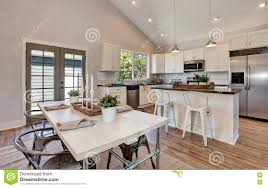 Interior Of Kitchen And Dining Room With High Vaulted Ceiling