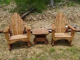 Handmade Adirondack Rocking Chairs W/Table, Cedar Or Stained ... Lakeland Mills Patio Glider With Contoured Seat Slats Briar Hill Adirondack White Cedar Outdoor Rocking Chair 5 Rustic Low Back Rocker Chairs The Ozark New York Craftsman Style Fniture Traditional Porch Sunnydaze Decor Fir Wood Log Cabin Loveseat Fan Design 2person 500 Lbs Capacity Generations Chaircedar Unfinished Branded Fish 25w X 36d 39h 23 Wide Swivel Natural High Double