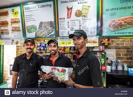 Mumbai India Asian Churchgate Jamshedji Tata Road Subway Sandwich Shop Restaurant Man Employee Coworkers Uniform