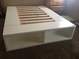 queen size white painted wooden low profile bed frame with storage