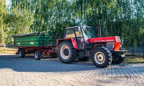 Download Old Farm Tractor With Trailer Editorial Photo