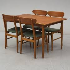 A 1960´s Dining Table With Four Chairs. - Bukowskis Ding Room Fniture Cluding A Table Four Chairs By Article With Tag Oval Ding Tables For 8 Soluswatches Ercol Table And Chairs Elm 6 Kitchen Room Interior Design Vector Stock Rosewood Set Extendable Whats It Worth Find The Value Of Your Inherited Fniture Wikipedia Danish Teak Wood Chairs Circa 1960 Set How To Identify Genuine Saarinen Table Scandart Vintage Mid Century S Golden Elm Extending 4
