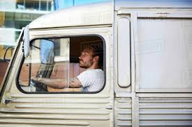 100 Food Truck Window Side View Of Young Male Owner Driving Food Truck In City Stock