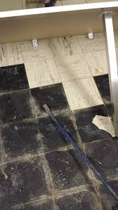Covering Asbestos Floor Tiles With Hardwood by What To Do With Wet Asbestos Floor Tile And Black Adhesive