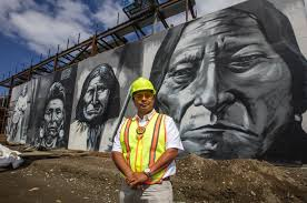 100 Andrew Morrison Artist Stands Friday With His Saved Murals Of Chief
