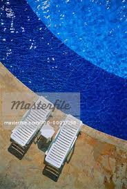 Overhead View Of Deck Chairs Next To Swimming Pool Cancun Mexico